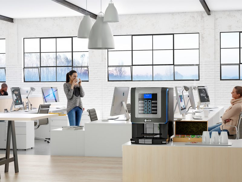 coffee machine in an office with workers at computers