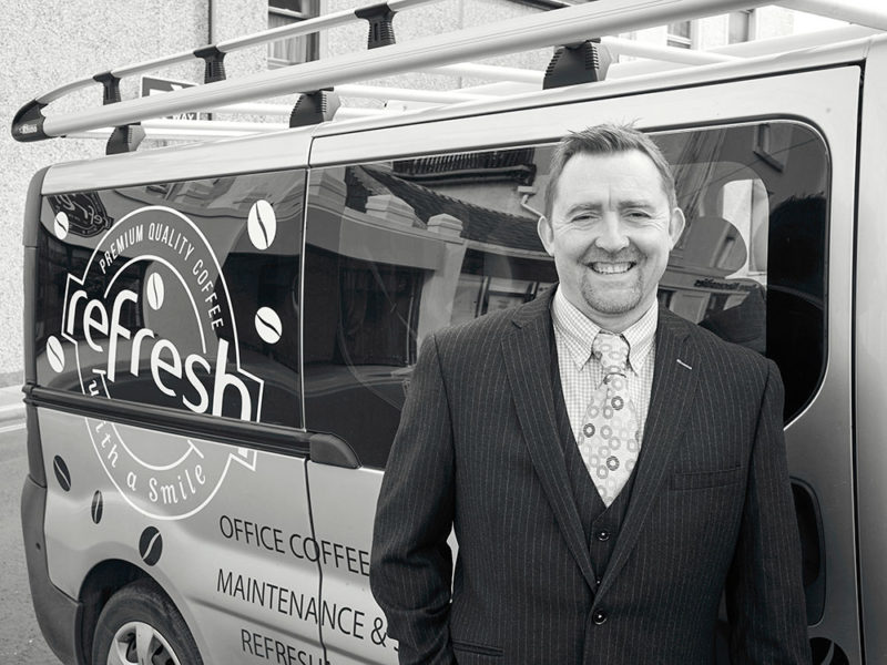 Shane Martin standing in front of the Refresh van